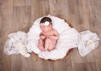 Photo bébé endormi couffin